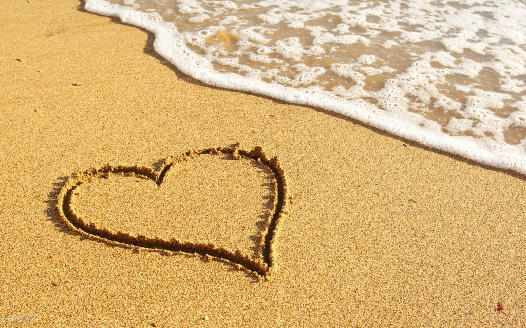 heart-drawn-in-the-sand-on-the-beach